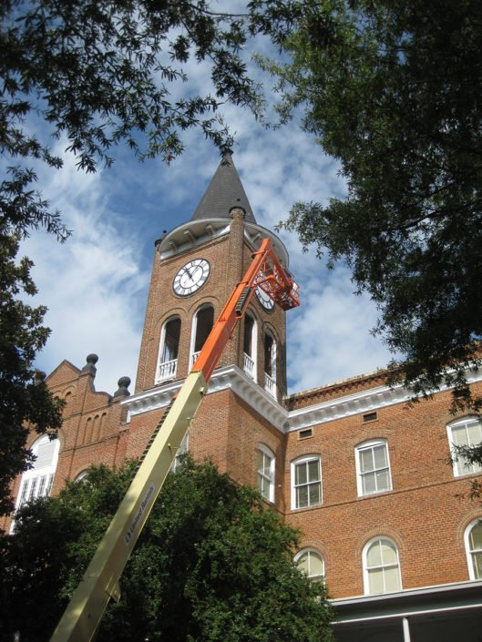 Workers install new clock faces at Wilson Hall Converse College 02