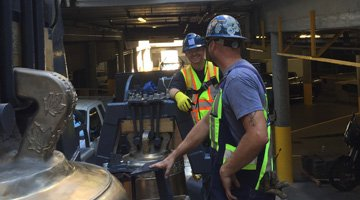 Foundry Workers Install Cast Bronze Bells