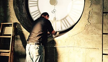 Bell Foundry worker services a tower clock